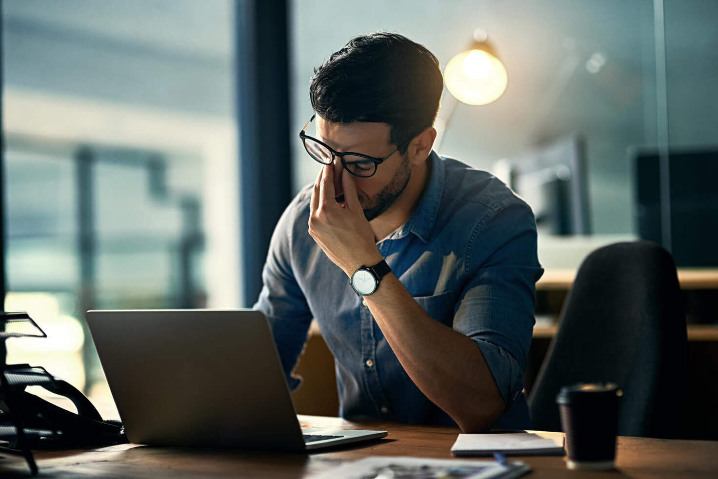 Man thinking in front of laptop-1